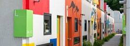 Alley of colourful student bungalows in the Olypmic Village.