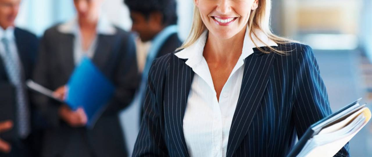 Smiling woman wearing business-clothes.
