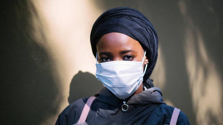 Woman with a mouth-nose cover