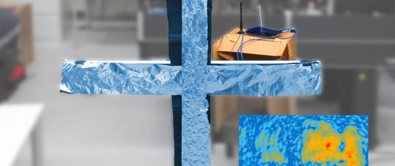 A cross made of aluminum foil between the viewer and the WLAN-router can easily be reconstructed from the WLAN-hologram as can be seen in the inserted picture (image: Friedemann Reinhard/Philipp Holl / TUM)