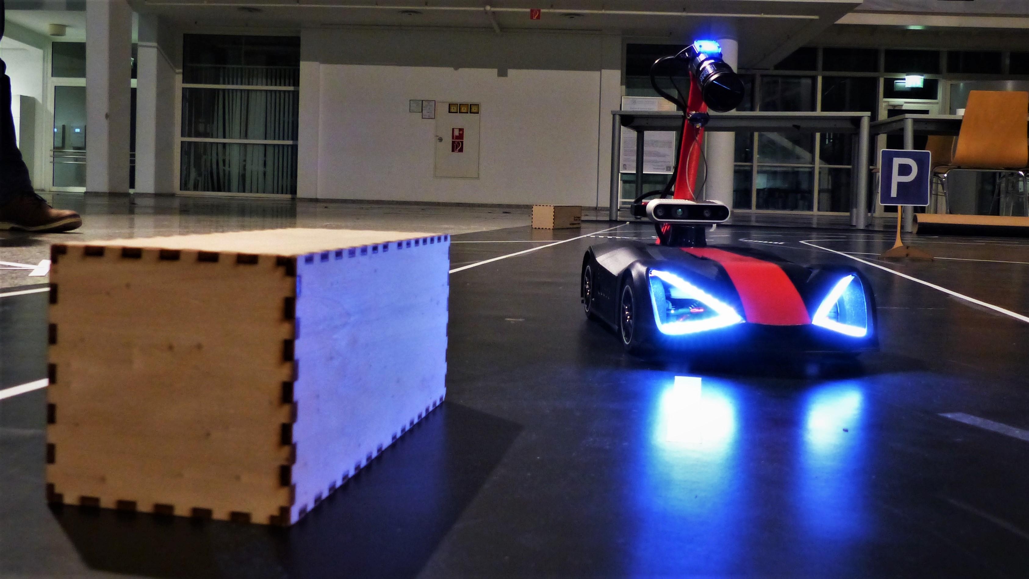 Robot model car is driving on a miniature street obstacle course