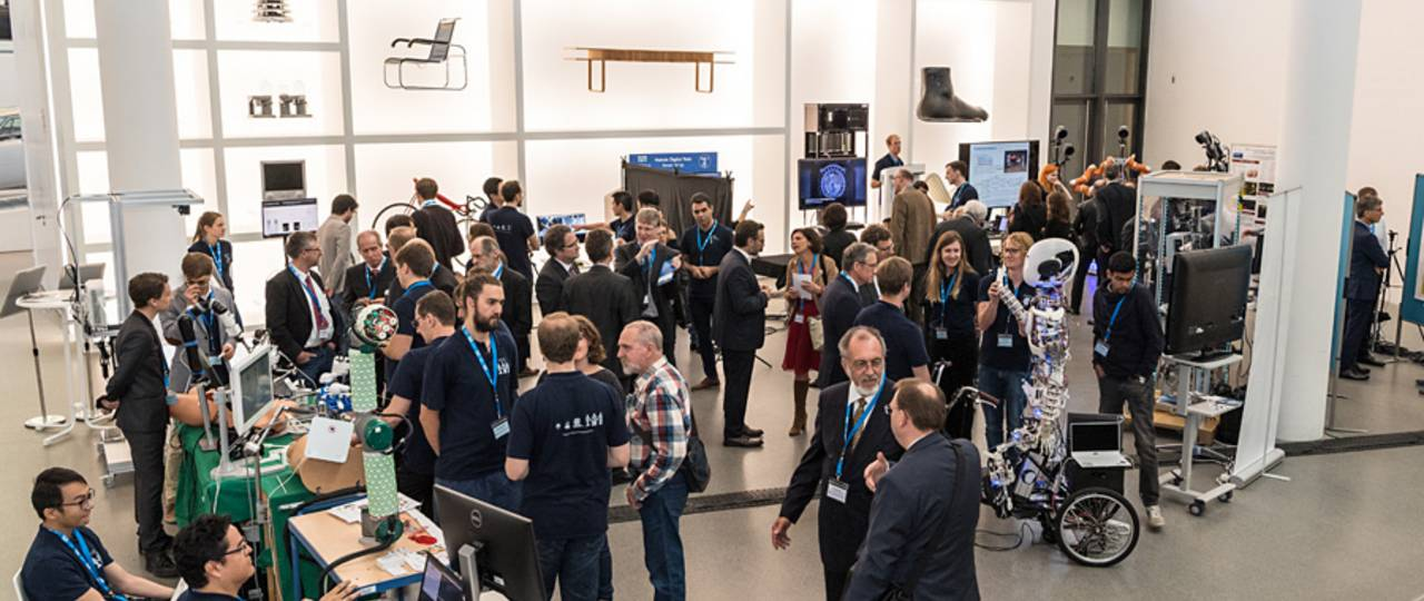 Science projects among design object: Several of TUM's robotics research groups presented their projects at Pinakothek der Moderne. (image: U. Benz / TUM)