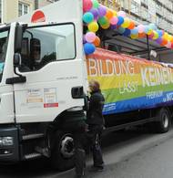 Truck with banner of TUM
