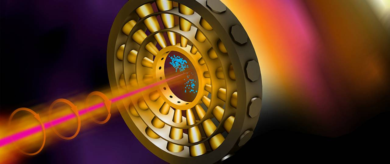 Cover of the April issue of Nature Photonics: Ultrashort X-ray pulses (pink) ionize neon gas in the center of the ring. An infrared laser (orange) deflects the electrons (blue) on their way to the detectors. (Image: Terry Anderson / SLAC National Accelerator Laboratory)