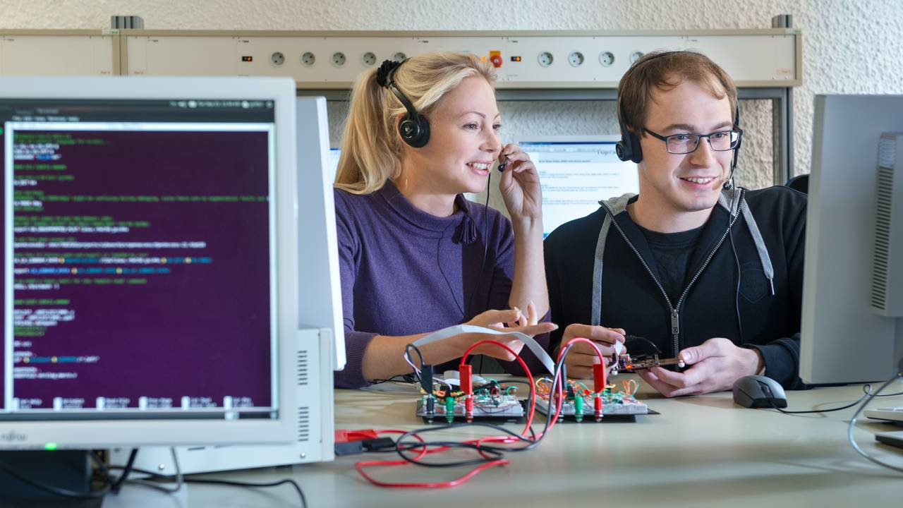 Researchers in a computer science lab.