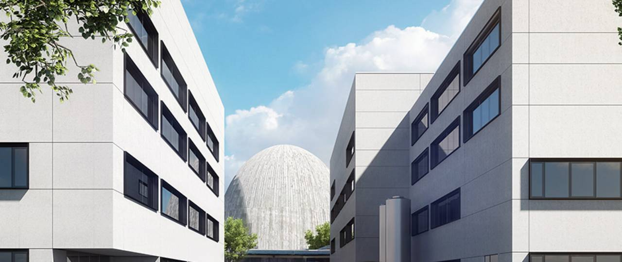 "The ""Atomic Egg"" peeks out between the new research buildings for the Heinz Maier Leibnitz Zentrum – Image: HENN"