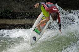 A surfer riding the Eisbach wave