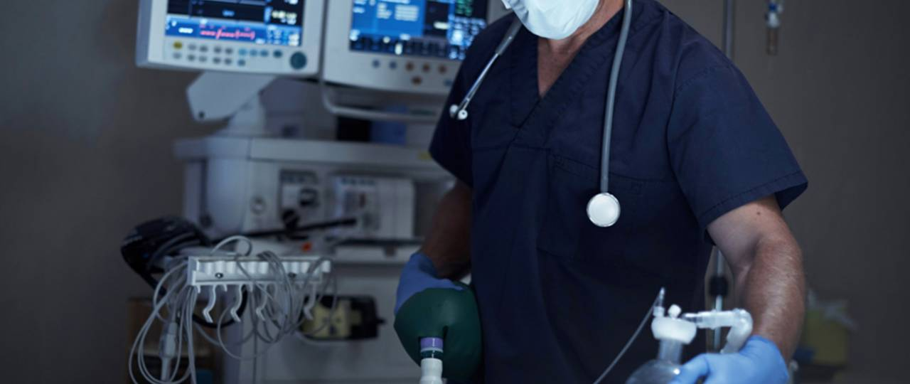 A man administering anesthesia.