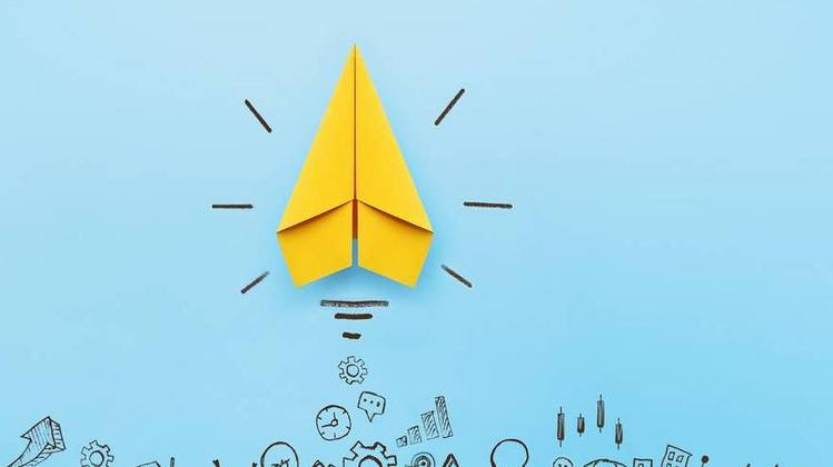 yellow paper airplane on blue background