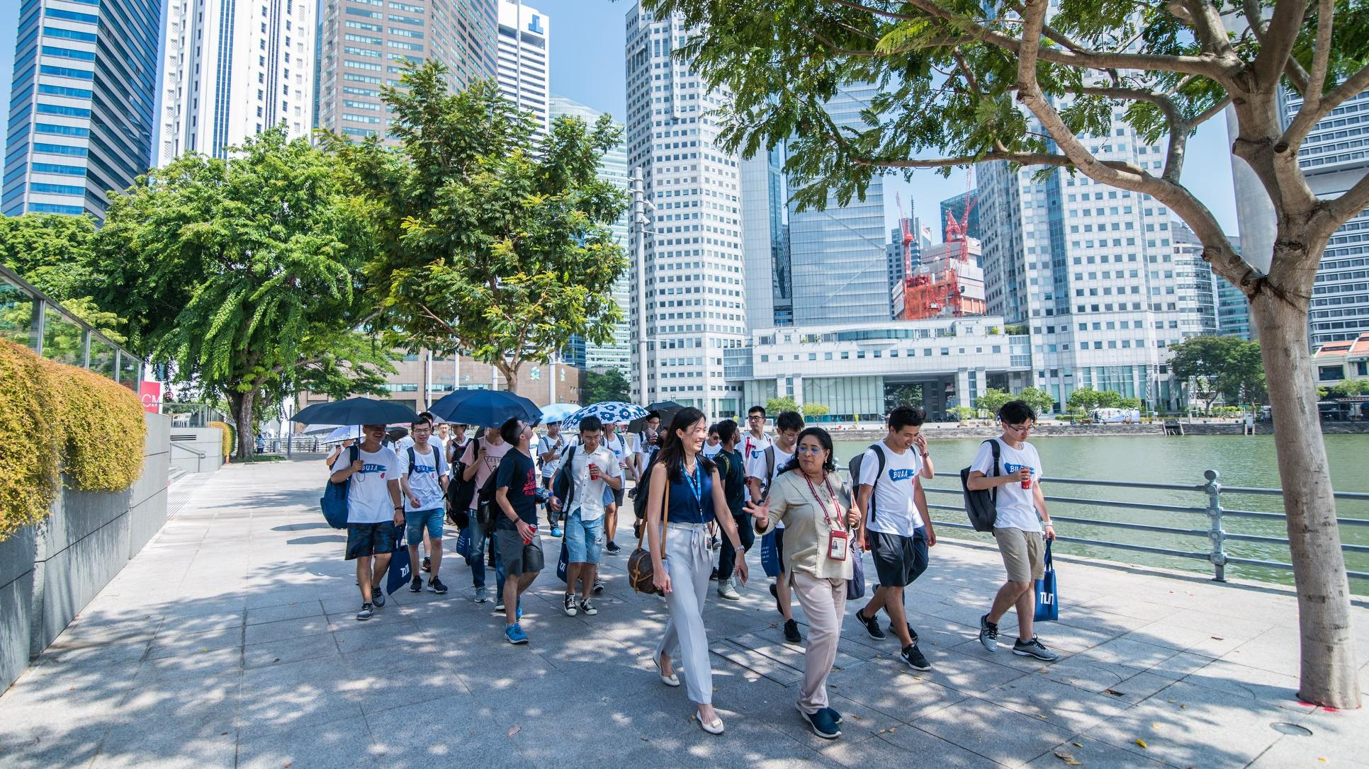 A group of students walking through the city of Singapore