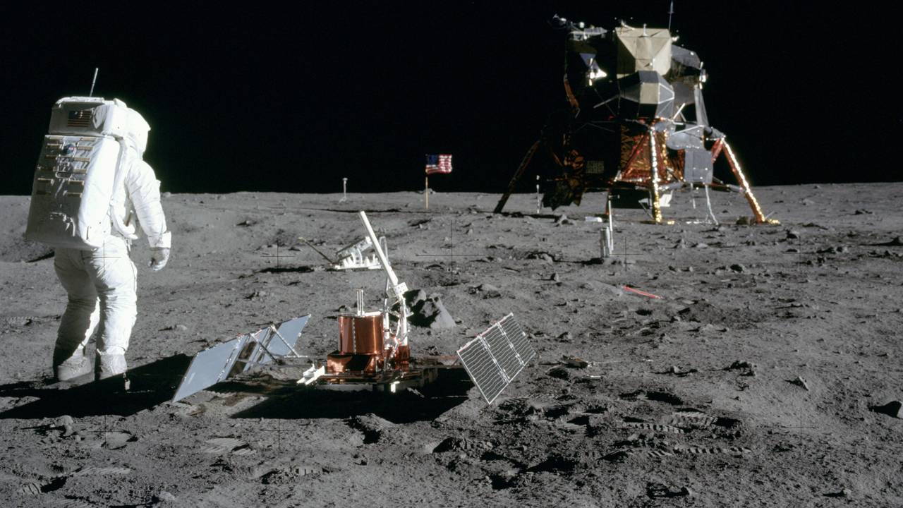 The historical photo shows Buzz Aldrin, who has just built the seismometer on the lunar surface (front).