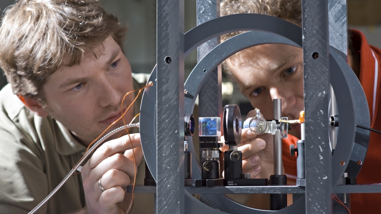 Physics Professor Peter Fierlinger and doctoral candidate Florian Kuchler prepare an experiment