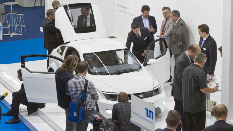 The electric car MUTE is surrounded by journalists at the International Motor Show (IAA)