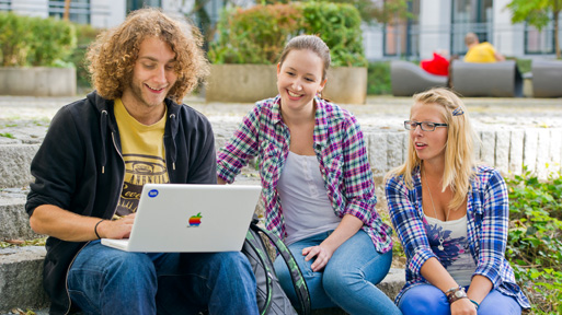Students with a laptop on campus