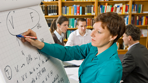 Student calculates on a flip chart