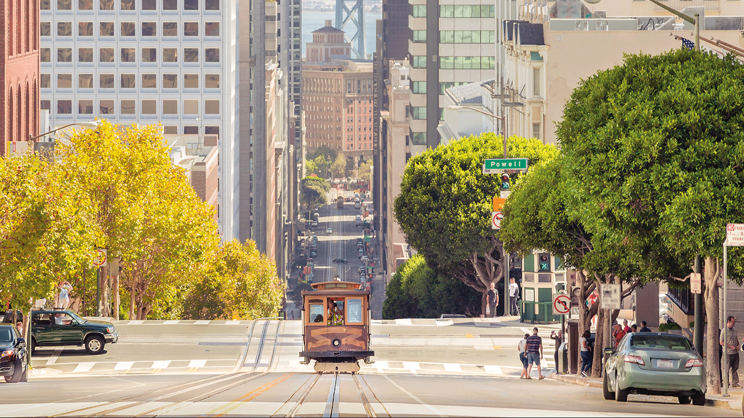 Classic view of historic traditional Cable Car riding on famous California Street in beautiful evening light at sunset in summer