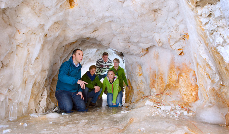 Engineering geologist Prof. Michael Krautblatter with students in a cave