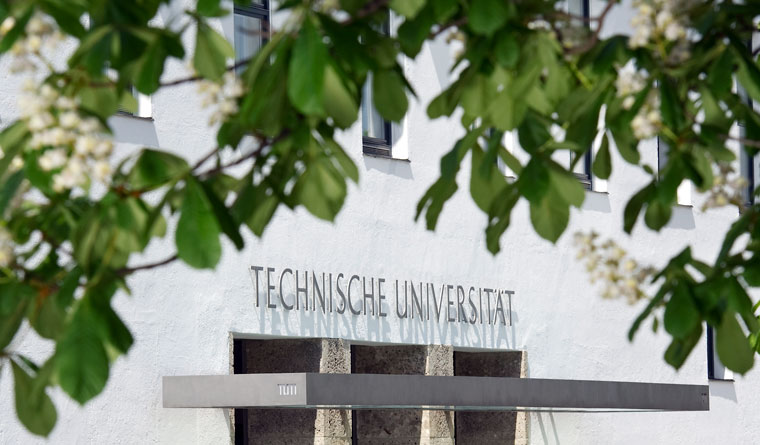 Main entrance to the Technical University of Munich (TUM) on Arcisstraße during springtime